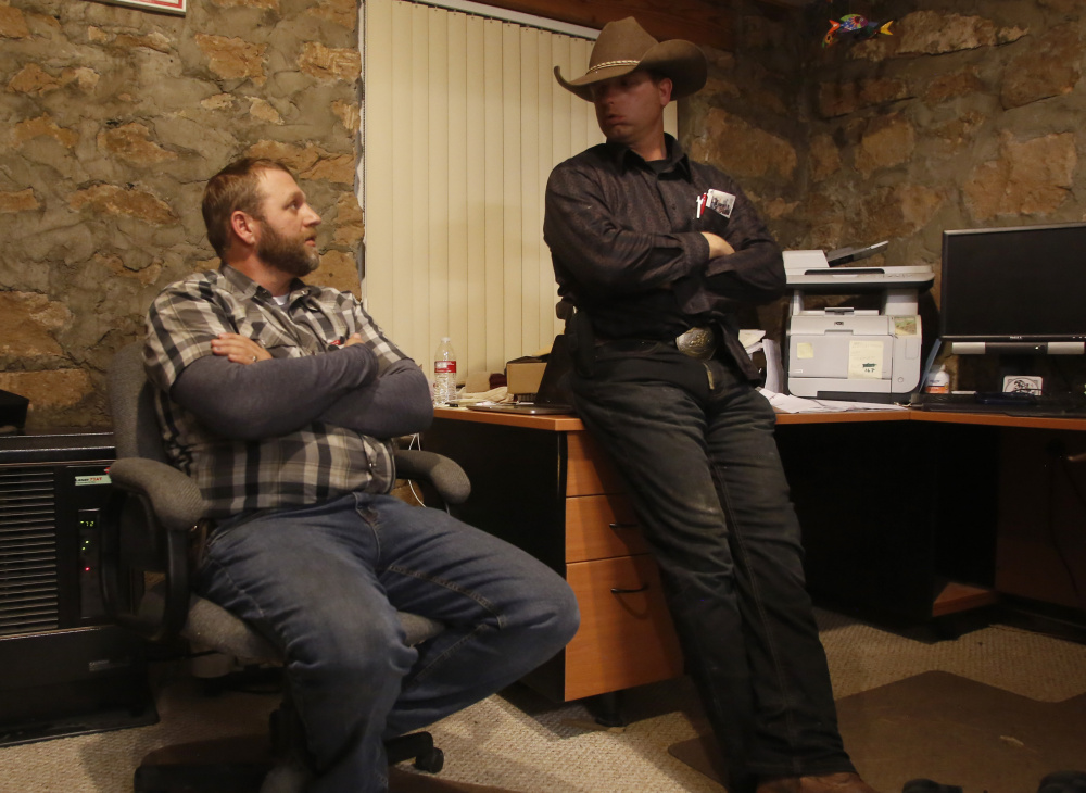 Ryan Bundy, right, and his brother Ammon Bundy in an office at the Malheur National Wildlife Refuge near Burns, Ore., in January.