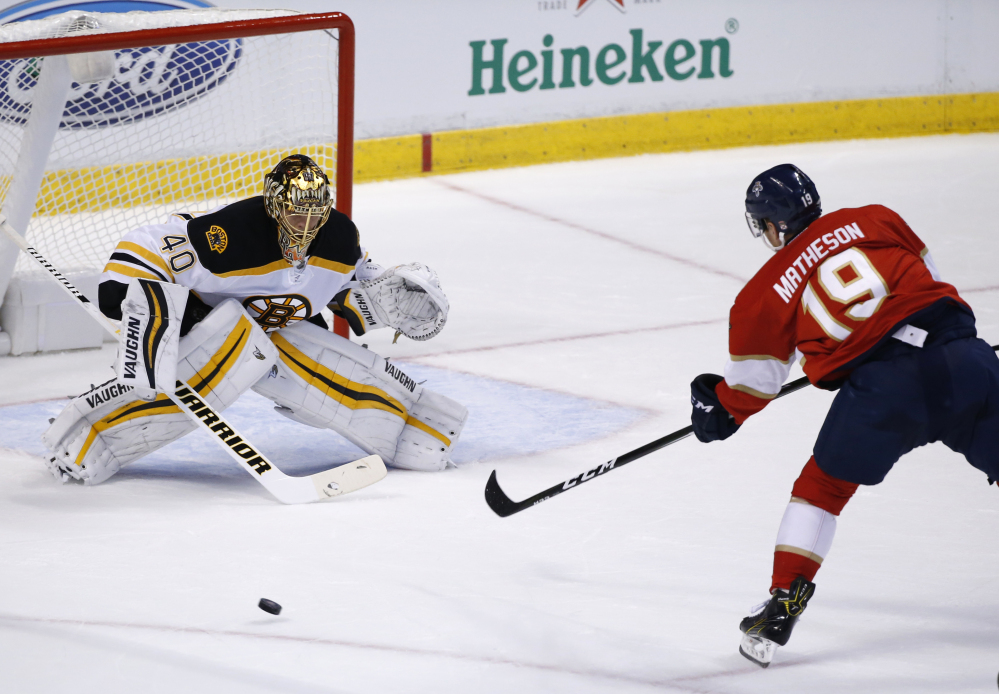 Bruins left wing Brad Marchand puts the puck past Florida goalie Roberto Luongo on a penalty shot in the first period, giving Boston a 1-0 lead.