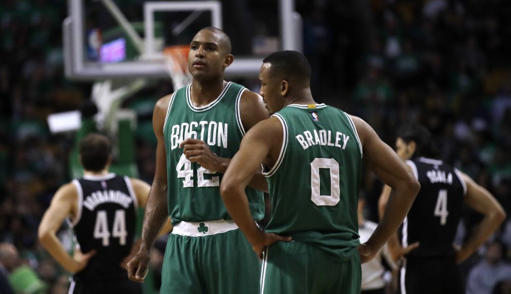 Boston center Al Horford, left, will not play for the Celtics on Wednesday night after entering the NBA's concussion protocol. A collision during practice on Monday did not manifest itself until Tuesday, and the team decided he will not play against the Bulls.
