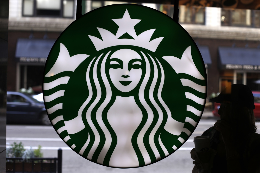 The Starbucks logo appears at one of the company's coffee shops in downtown Chicago. Starbucks reported financial results Thursday.