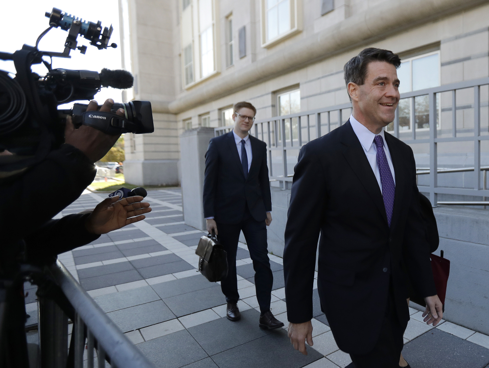 Bill Baroni, right, New Jersey Gov. Chris Christie's former top appointee at the Port Authority of New York and New Jersey, arrives at Martin Luther King, Jr., Federal Court Friday in Newark, N.J.