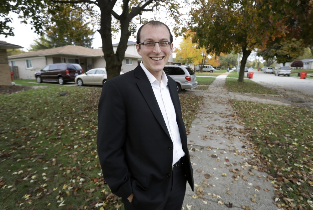 Moshe Sherizen, an undecided voter, is shown outside his home in Southfield, Mich. An undecided voter, Sherizen considers himself a Democrat but also a risk-taker and likes Trump's pledge of tough immigration policies to keep out potential terrorists.