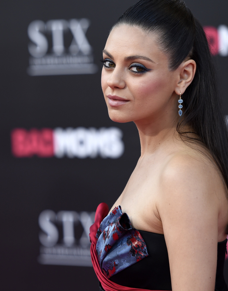 Actress Mila Kunis poses at the premiere of