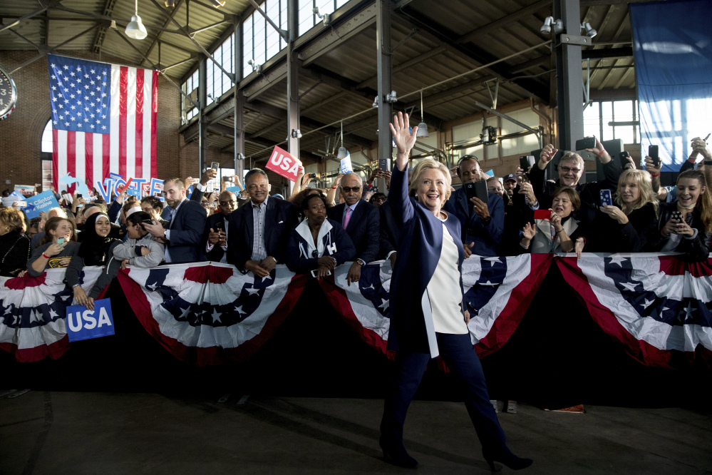 Democratic presidential candidate Hillary Clinton arrives to speak at a rally at Eastern Market in Detroit, Friday, Nov. 4, 2016. (AP Photo/Andrew Harnik)