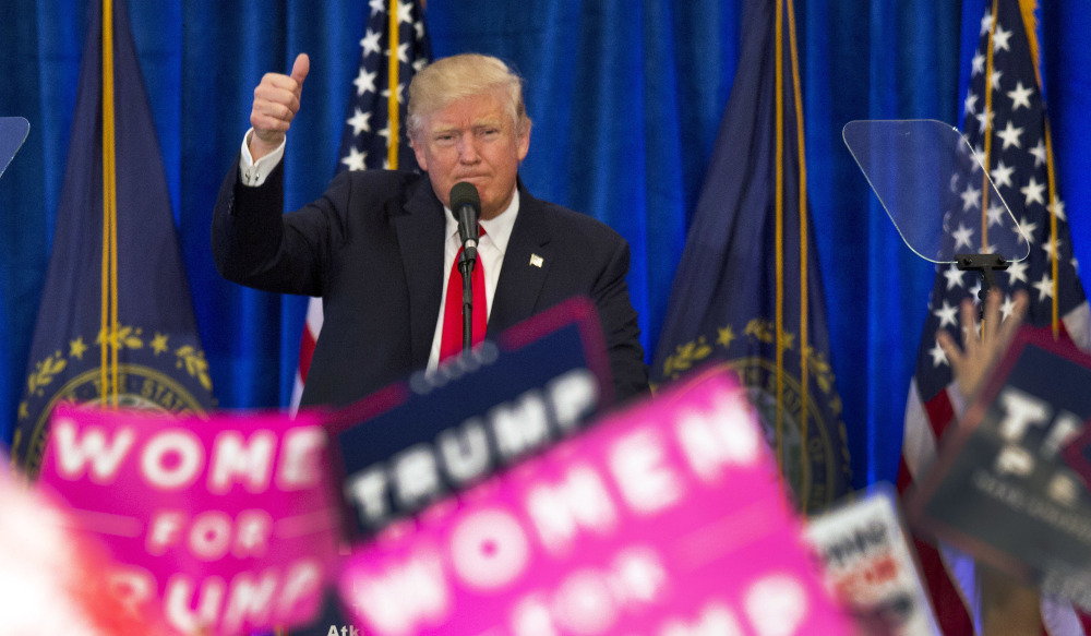 Republican presidential candidate Donald Trump gives his trademark thumbs-up to supporters during a campaign rally in Atkinson, N.H., on Friday.