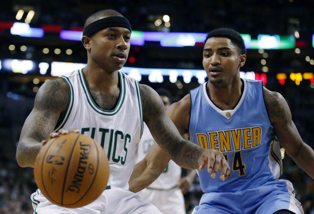 Denver's Gary Harris, right, defends against Boston's Isaiah Thomas during the first quarter of the Nuggets' 123-107 victory in Boston on Sunday.