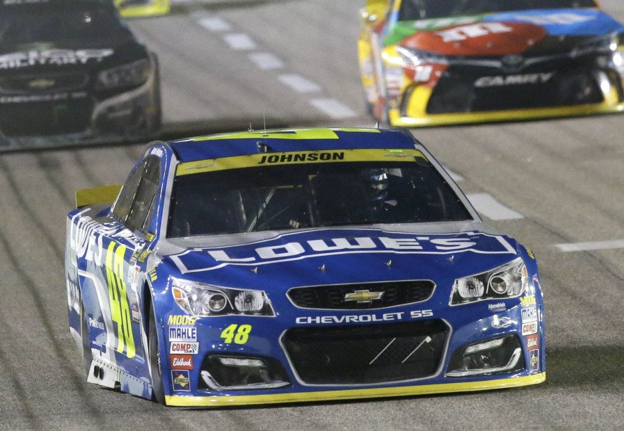 Jimmie Johnson drives into turn one ahead of other drivers during the NASCAR Sprint Cup Series race Sunday at Texas Motor Speedway in Fort Worth, Texas.