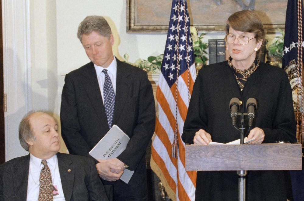 Attorney General Janet Reno, accompanied by President Bill Clinton and James Brady, speaks at a 1995 White House ceremony marking the one-year anniversary of the Brady handgun control law. Reno was the first woman to serve as U.S. attorney general.