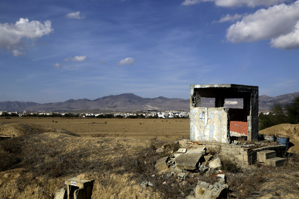 An abandoned Cypriot guard post which was being used by the military, stands on the outskirts of the Turkish Cypriot breakaway north part of the divided capital Nicosia in the eastern Mediterranean island of Cyprus, Sunday, Nov. 6, 2016. Past efforts to solve the ethnical division of Cyprus have failed, but the leaders are heading to the Swiss resort of Mont Pelerin for meetings next week that could be the precursor to one last summit to sort out the final details of a deal.
