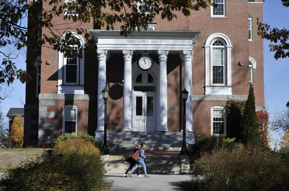 Students walk past Hathorn Hall on the Bates College campus in Lewiston.