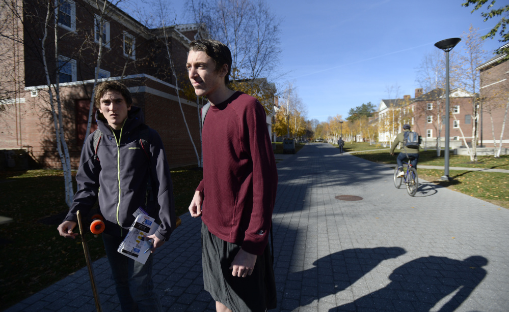 "Bates College students Bryce O'Brien, left, of Bristol, R.I., and Justin Levine of Boca Raton, Fla., discuss the fliers circulated on the campus that could be viewed as an attempt at voter suppression. O'Brien said he's heard a lot of students describe the fliers as ""disgusting."""