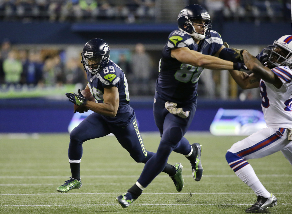 Seattle's Doug Baldwin gets a block from Jimmy Graham and runs for yardage in the first half Monday night in Seattle. The Seahawks won 31-25.