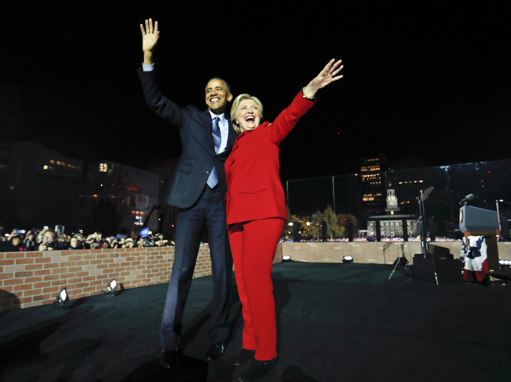 President Barack Obama waves on stage with Democratic presidential candidate Hillary Clinton during a rally at Independence Hall in Philadelphia Monday.