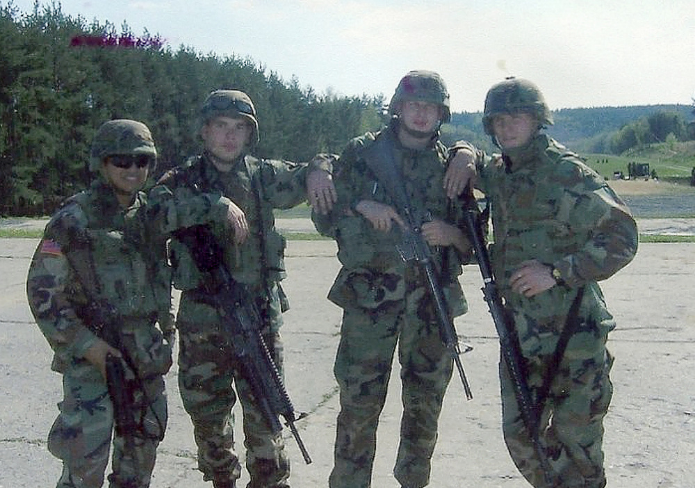Bryan Noyes, left, with his forward observer team in the field in Germany.