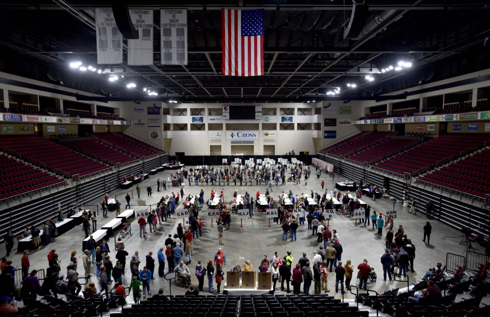 Voters fill the Cross Insurance Center in Bangor to cast their ballots on Tuesday. Outside the building, 2nd Congressional District candidates Bruce Poliquin and Emily Cain were spending the final minutes of the campaign greeting voters outside.
