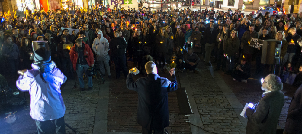 The Rev. Benjamin Shambaugh of St. Luke's Cathedral in Portland addresses hundreds of participants in a unity vigil in Monument Square in Portland on Wednesday.