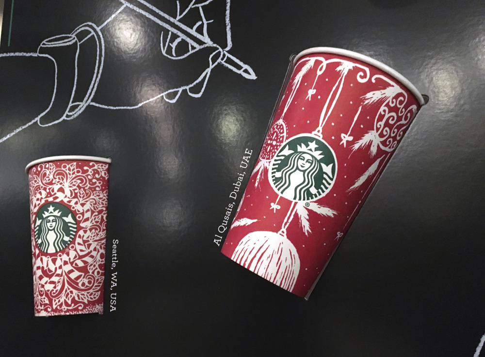Thirteen different holiday cups will hit Starbucks stores around the world Thursday. Now President-elect Donald Trump had suggested boycotting the chain last year.