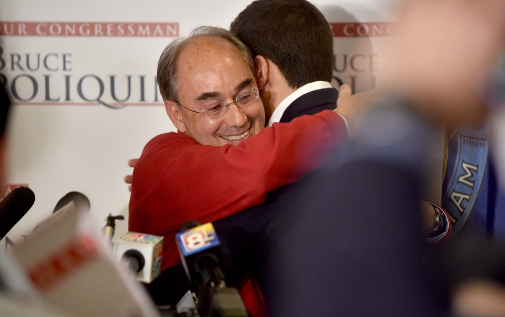 U.S. Rep. Bruce Poliquin hugs son Sam at Dysart's Restaurant in Bangor after defeating Emily Cain on Tuesday. His decisive victory could point to a growing conservatism in the district.