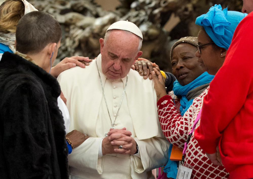 Pope Francis is greeted by the faithful during an audience with the participants of the homeless jubilee Friday at the Vatican.