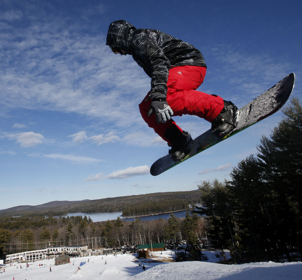 A snowboarder catches some air at Shawnee Peak. The Bridgton ski area has made upgrades to its base station and a major renovation of its rental shop.