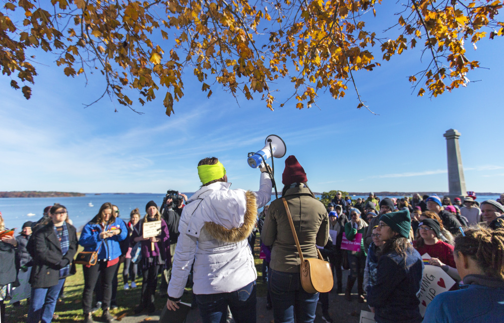 PORTLAND, ME - NOVEMBER 12: Melissa Kenison, center left, and Chelsea Ellis use a megaphone to organzie hundreds of protesters in a march from Eastern to Western Promenade to protest President-Elect Donald Trump. (Photo by Ben McCanna/Staff Photographer)