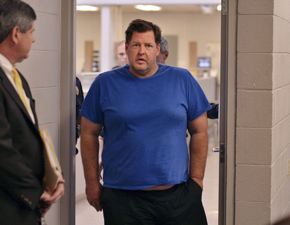 Todd Kohlhepp is escorted into a Spartanburg courtroom on Friday. Kohlhepp, a 45-year-old registered sex offender with a previous kidnapping conviction, allegedly killed 7 people.
