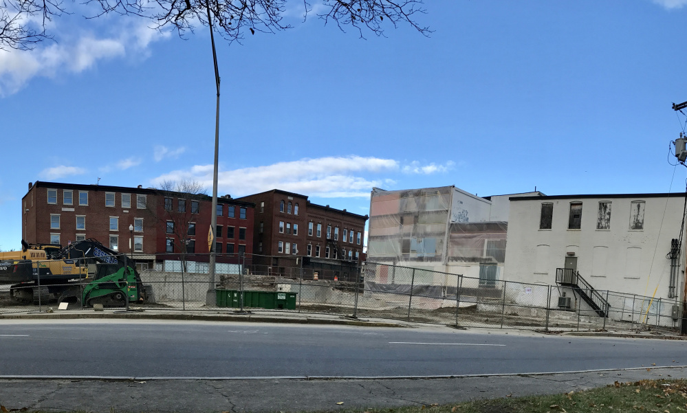 The former Levine's building, seen before demolition, in downtown Waterville has been largely torn down.