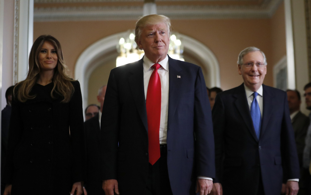 President-elect Donald Trump and his wife Melania walk with Senate Majority Leader Mitch McConnell of Kentucky after at meeting on Capitol Hill on Thursday. Trump has already appointed many wealthy donors to key roles.