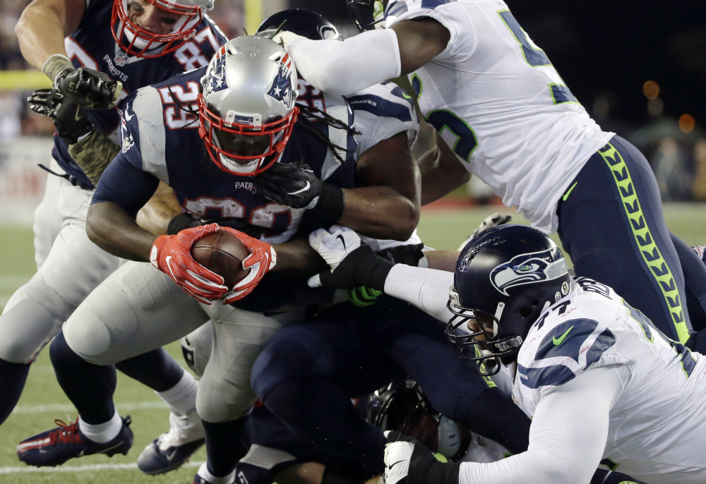 Patriots running back LeGarrette Blount scores in the first half Sunday night against the Seattle Seahawks at Gillette Stadium. The Patriots lost for just the second time this season, 31-24.