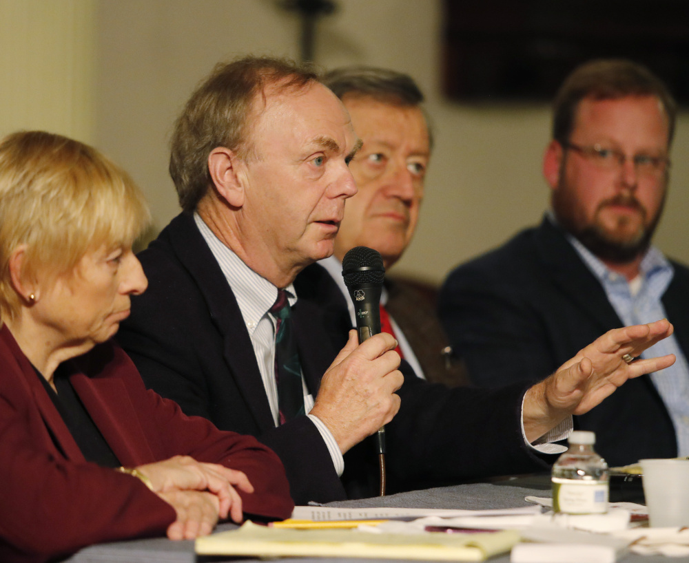 Author and political strategist Alan Caron, center, joined by, left to right, Attorney General Janet Mills, former chairman of the Maine Democratic Party Severin Beliveau and Lance Dutson, speaks at Monday's forum at the First Parish Church.