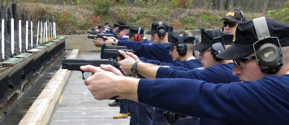 Connecticut State Police recruits practice with their new .45-caliber Sig Sauer pistols during a