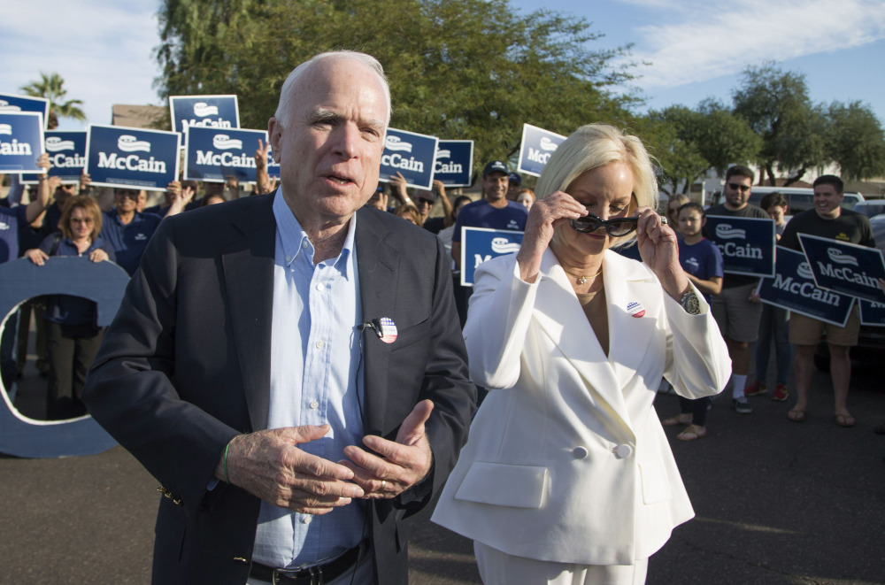 Sen. John McCain, shown with wife Cindy McCain in Phoenix on Election Day, says President-elect Donald Trump's attempted 'reset' with Russia is out of line.