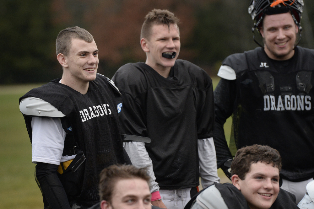 Devereaux, left, shares a laugh with teammates during practice Wednesday. Shawn Patrick Ouellette/Staff Photographer