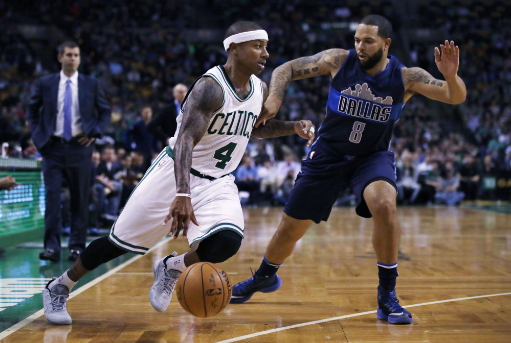 Boston Celtics guard Isaiah Thomas (4) drives to the basket against Dallas Mavericks guard Deron Williams (8) during the first quarter of an NBA basketball game in Boston Wednesday. (Associated Press/Charles Krupa)