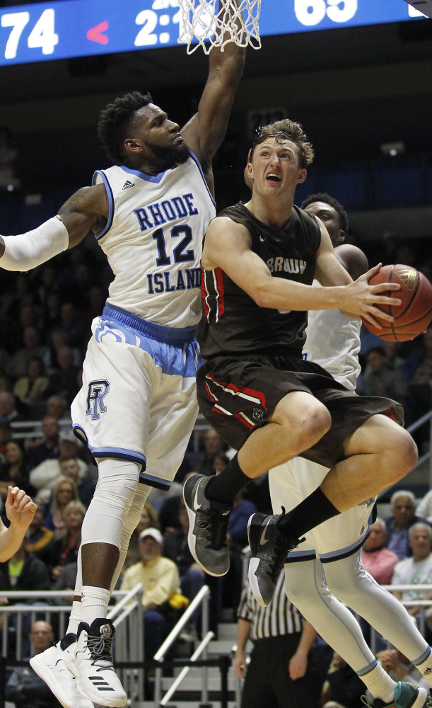 Brown's Steven Spieth looks for a shot as Rhode Island's Hassan Martin defends during Rhode Island's 79-72 win in Kingston, R.I.