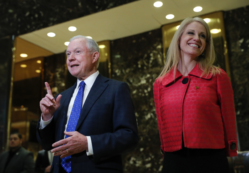 Sen. Jeff Sessions, R-Ala., and Kellyanne Conway, campaign manager for President-elect Donald Trump, speak to reporters at Trump Tower in New York on Thursday.