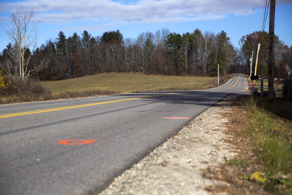 Brandon Dumond was killed after being struck by a car while riding his bicycle along this stretch of Anderson Road in Windham on Wednesday evening. A Scarborough man has been charged.
