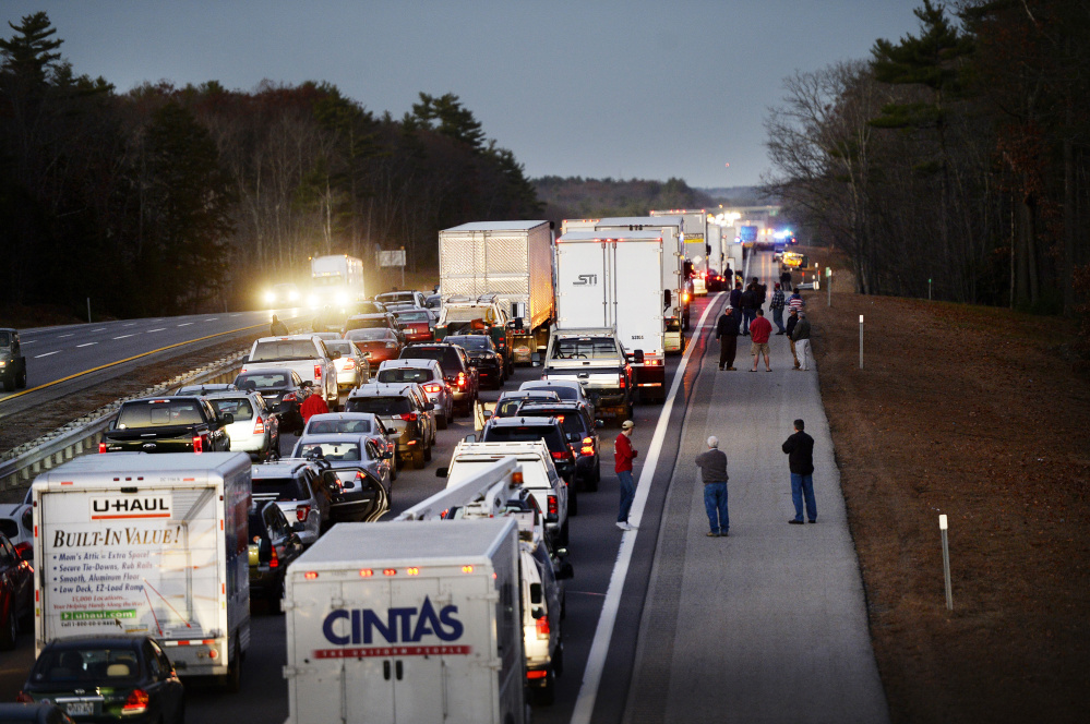 Traffic backed up for miles on the Maine Turnpike after the fatal crash Nov. 18 in Wells. Investigators say the driver of the box truck that crashed into a car had more than 20 convictions for driving violations.