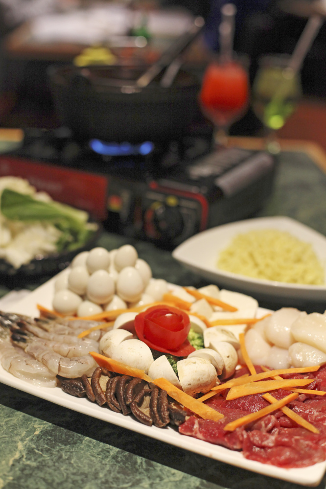 This hot pot features house special broth, fish cakes, raw steak, rice noodles, shiitake mushrooms, bok choi and fresh tofu.