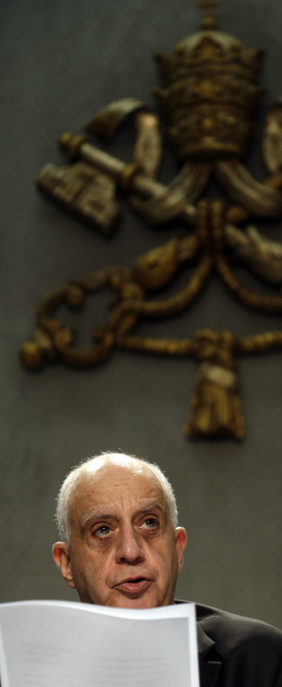 At the Vatican on Monday, Monsignor Rino Fisichella reads an Apostolic Letter that Pope Francis signed Sunday, the day the Holy Year of Mercy ended.
