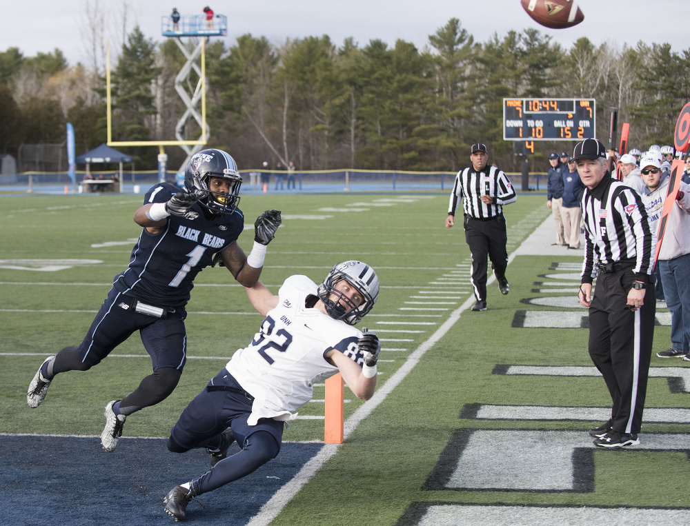 UMaine's Najee Goode chases UNH's Neil O'Connor into the end zone as the ball is overthrown by UNH's Adam Riese during the first half Saturday in Orono. New Hampshire beat Maine to end the Black Bears' season. Kevin Bennett Photo