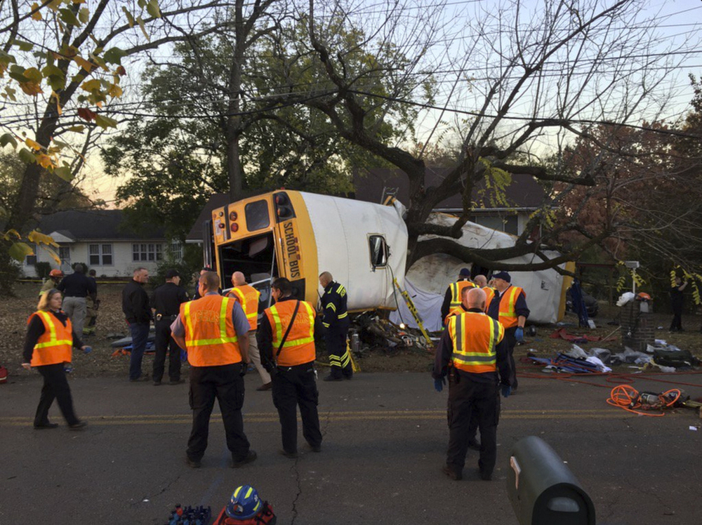 Chattanooga Fire Department personnel work at the scene of the fatal school bus crash in Chattanooga, Tenn., on Monday. Assistant Chief Tracy Arnold said there were multiple fatalities.