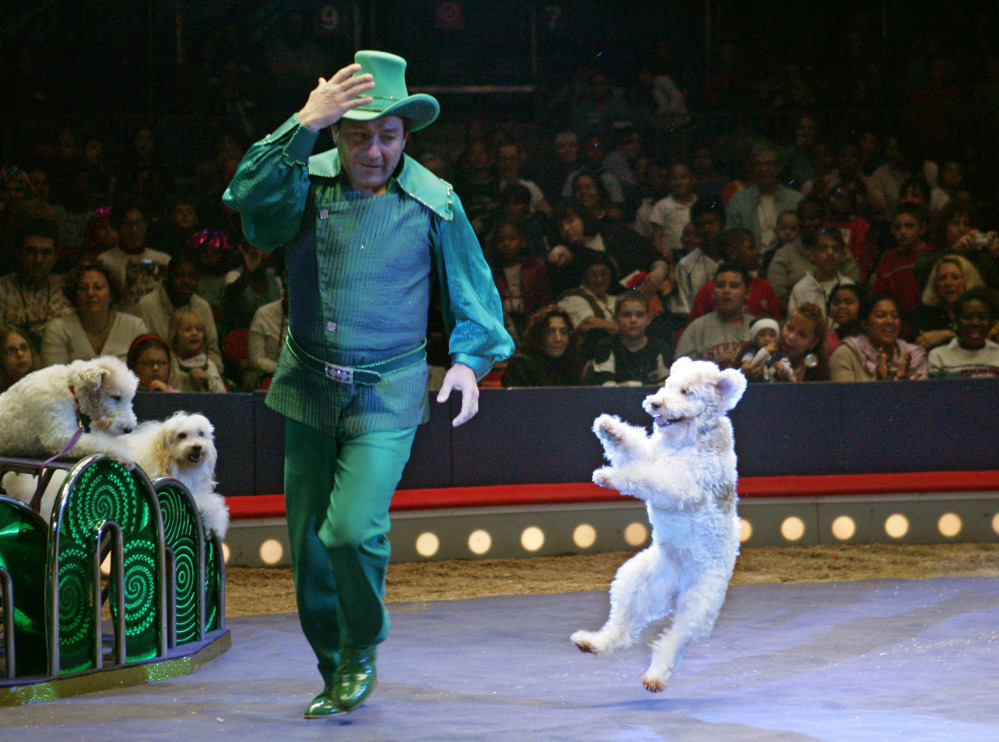 Richard Olate, of Chile, runs around the ring followed by one of his trained dogs in the Big Apple Circus at New York's Lincoln Center in 2005. The circus is filing for bankruptcy protection after four decades of entertaining the world.