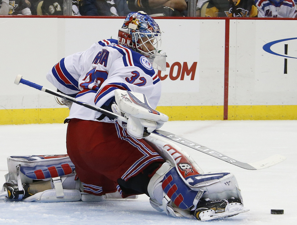 New York Rangers goalie Antti Raanta makes one of his 29 saves in a 5-2 win over the Penguins at Pittsburgh on Monday.