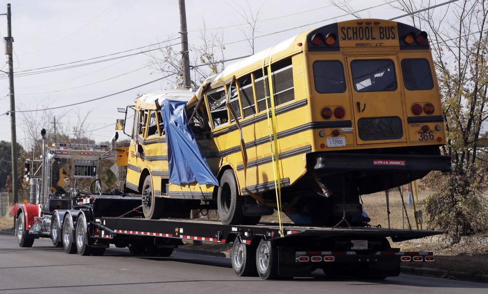 The bus that crashed Monday in Chattanooga, Tenn., is taken away from the crash site. Students and administrators raised concerns about the bus driver in the weeks before the crash, which killed six children.