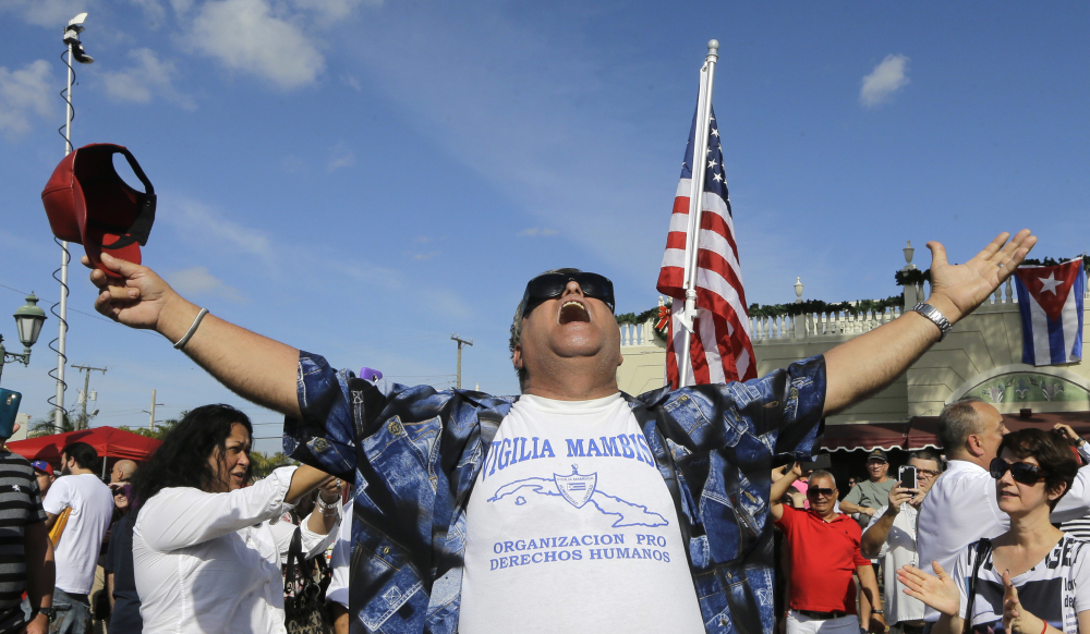 A member of the Cuban community cheers the death of Fidel Castro on Saturday.