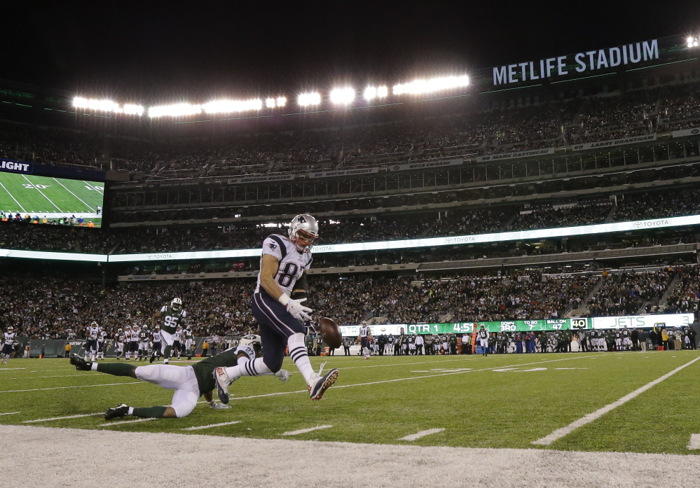 Jets' cornerback Darryl Roberts breaks up a pass intended for Patriots' tight end Rob Gronkowski during the first quarter Sunday in East Rutherford, New Jersey. Gronkowski left the game with a back injury and is questionable to return.