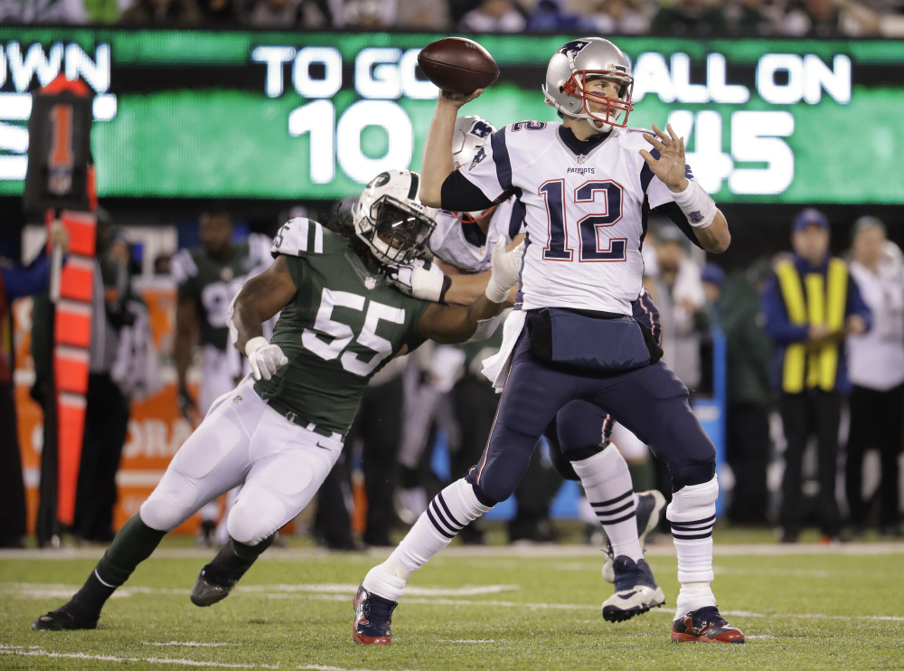 It was a day of milestones for Patriots quarterback Tom Brady, who got his 200th career win and also surpassed the 60,000-yard passing mark for his career while leading New England to a 22-17 win over the Jets.