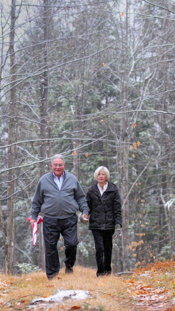 John and Lisa Rosmarin stroll Friday in Readfield on land their family donated to the Kennebec Land Trust.