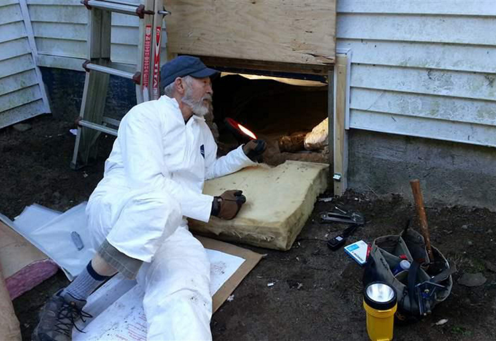 Dave Brown, 75, a volunteer for the Harpswell Aging at Home team, insulates the floor under a house. Volunteers are helping seniors remain in their homes, but there should be other options, as well.
